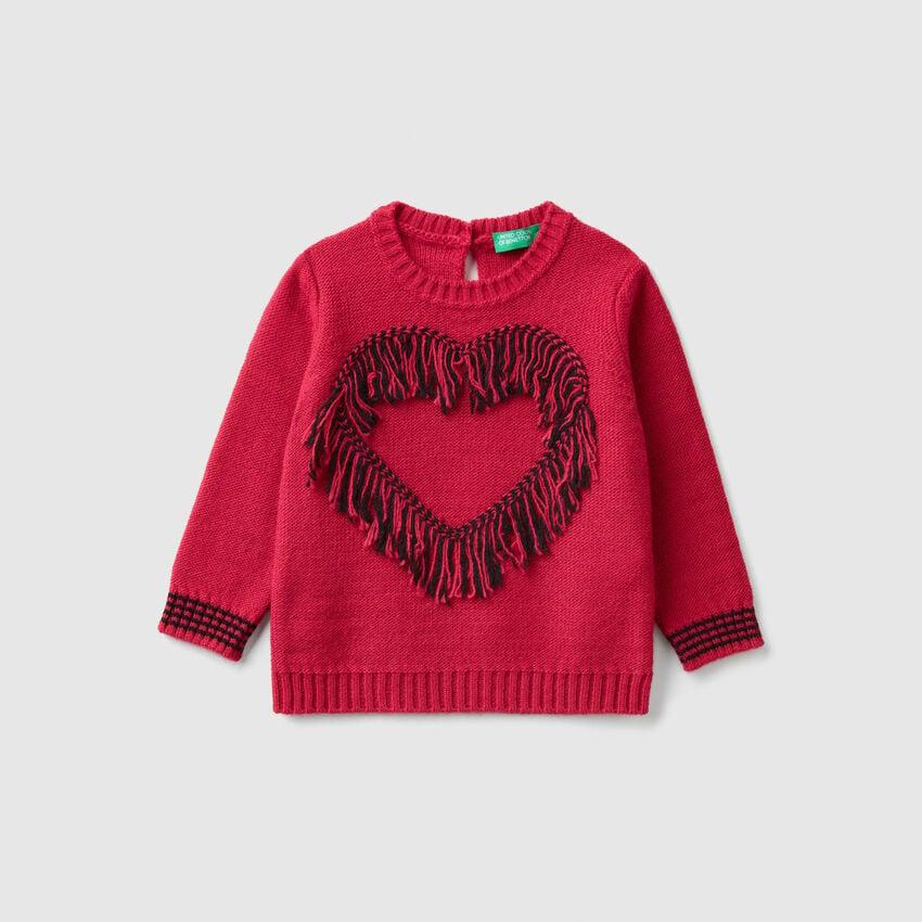 Pullover mit Herz und Fransen